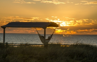 A sunset, a hammock, and a tropical beach ..what else could you want ?