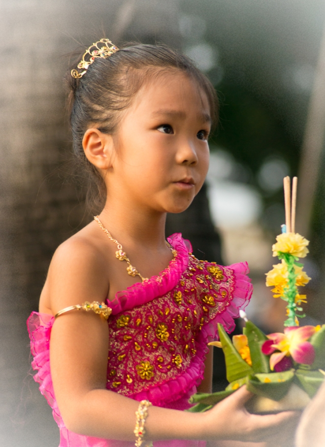 Young girl in traditional dress at Loy Krathong