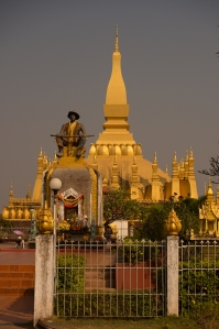 Statue of King Setthathirath in front of Pha That Luang