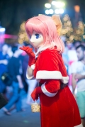 One of the cosplayers who had swapped her anime costume for a Christmassy one ...but not her mask.