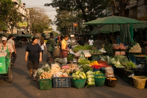 the fruit and vegetable traders spread out across the road.