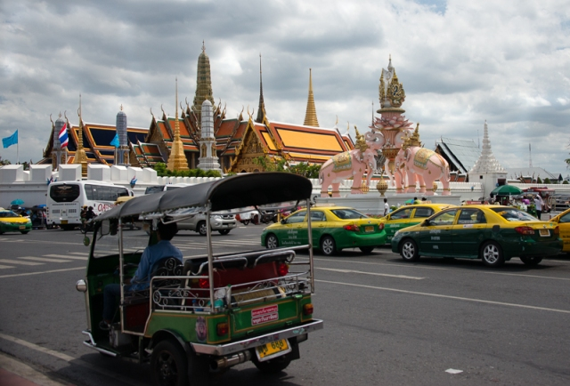 Taxis, tuk-tuks and pink elephants outside the Grand palace
