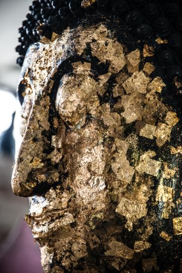 Gold leaf covered Buddha head.