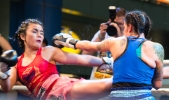 The Spanish girl in blue looked tough with her tatts, but the Thai girl put her down.