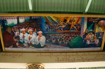Most temples have murals illustrating the teachings of Buddha. This modern mural shows the evils of sex,drugs and karaoke !