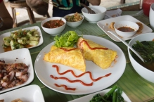 Rice with prawn meat, carrot, tomato sauce, all wrapped inside an omelette. Tastier than it sounds !